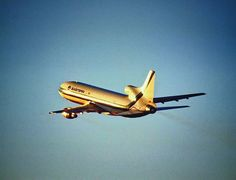 Eastern L-1011 taking off into sunset
