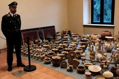 British museums linked to Sicilian 'loot dealer'  Alice Philipson, Rome; David Harrison Published: 8 February 2015  A police officer stands guard over some of the seized antiques