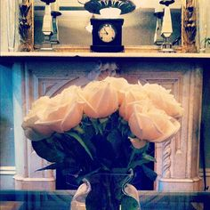 Lush roses on our Parlor Room table add to the elegance.