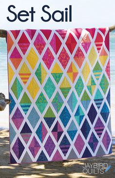 Meet my latest pattern, Set Sail! This quilt is all about diamonds and triangles that have fun together and make for great movement across the quilt top.  Quilt Details Fabric is True Colors by Tula P