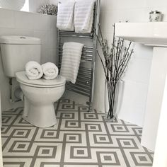 How do you make a small space stylish? 🤔 You use our New Orleans Estelle Vinyl flooring! It looks amazing, helping keep this bathroom on-trend! 😍 🛒 Order your Free Samples today! #Bathroom #BathroomFlooring #Vinyl #VinylFlooring #FlooringTrends #Bathroom #FlooringSuperstore #Flooring #FlooringTrends #WoodFlooring #EngineeredWood #Home #InstaHome #InstaStyle #Interiors #Interior #Laminate #Vinyl #Lvt #Carpet #Carpets #InteriorDesign #Decor #Decorating #HomeDecor #Renovating #HomeSweetHome Vinyl Flooring, Bathroom Flooring, Bathroom Vinyl, White Tiles, Engineered Wood, Grey And White, New Orleans, Small Spaces, Modern Design