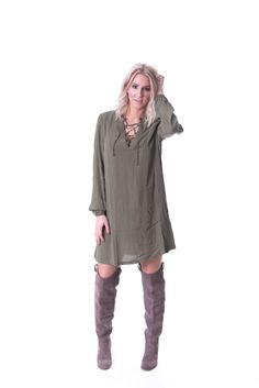 Lace up cleavage dress with gathered sleeves and a built in slip. Shop this gorgeous dress now at britain&brooks