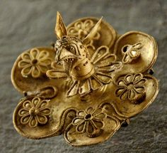 Greek Electrum Griffin Protome Brooch, c. 625-600 BCE. From the necropolis of Kameiros, Rhodes, Greece. The ancient site of Kameiros contains the ruins of the Hellenistic and Roman cities, along with a necropolis.