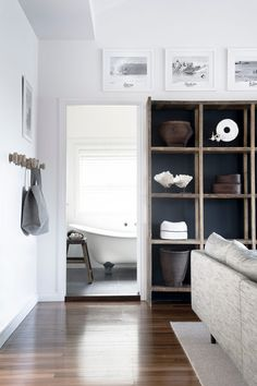 Like the wood and charcoal background.  For our entertainment nook maybe?  Looks good with the floors and the white walls.