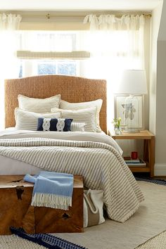 Blue and white bedroom with a nautical feel