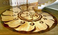, ID234. Check pictures of other inlays, wood and stone medallions, borders and parquet from Czar Floors.