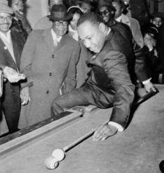 MLK playing pool.