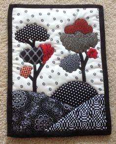 Black, white and red trees mug rug.