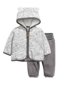 Fleece set: Fleece set with a hooded jacket and trousers. Jacket in marled, knitted fleece with a contrasting colour jersey trim, pile-lined hood with sewn-on ears and a zip down the front. Trousers in fleece with wide foldover ribbing at the waist.
