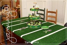 Indoor/outdoor carpet as a table covering. You can add tape (she used first aid tape lol) or even yard markings or just leave it plain grass. Easy and cute!