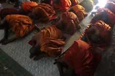 Bangladeshi Buddhist Monks pray at a meditation center at Ukhia in the coastal district of Cox's Bazar, Bangladesh. Pictures Of The Week, Cool Pictures, 28th October, Meditation Center, Buddhist Monk, Lion Sculpture, Coastal, Ryder Cup, Tiger Cub