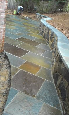 The rich natural tones in this walkway can be picked up on the exterior with accent paint colors Johnsons Landscaping Professional Landscaping, Stone Walkway, Brick And Stone, Outdoor Living, Outdoor Decor, Backyard Patio, Outdoor Walkway, Outdoor Projects, Garden Paths