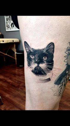 Realistic cat portrait tattoo on the right thigh. Tattoo artist:...