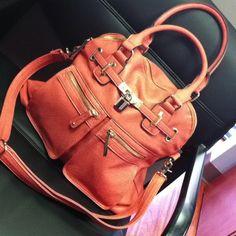 I'm embracing color. Salmon pink purse.