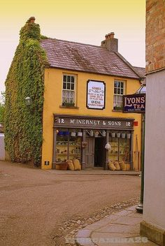 Old fashioned corner shop in England and Lyon's tea shop!-----*sigh* there are millions of corners in England. Wish this listed which town or village. Café Restaurant, Tee Shop, England, Fashion Corner, Shop Fronts, Restaurants, English Countryside, Mellow Yellow, Mustard Yellow