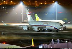 Night at Haneda Airport, Tokyo, Japan, as the ground crew see off a Russian State Transport Ilyushin Il-96-300