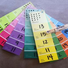 A counting activity made from paint chips... put a dot on the back behind the right answer so your little one can check her own answers! ;)  inspired by the word building paint chip activity but hadn't seen one for counting yet!