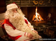 Santa Claus relaxing by the fire in Santa Claus Post Office in Rovaniemi in Lapland