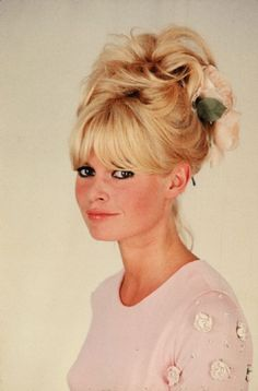Brigitte Bardot... love the height, the bangs and the pink flower. Not just anyone can pull this off