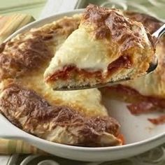 Pizza was never easier than this--spread the sauce, pepperoni and cheese on pizza batter and bake for 30 minutes for a savory, deep-dish treat.