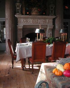 French bouilette lamps with candles as originally used. The shade would be lowered (as now with bulbs) to control the amount of light.