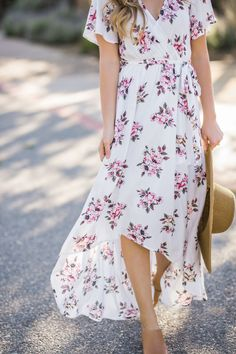 Our top selling Melody Floral Wrap Maxi Dress now comes in a new irresistible color! We love floral dresses and this white high-low maxi dress is no exception! The gorgeous Spring color, faux-wrap fro