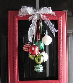 I love these ornament ideas. First, something other than a wreath for the front door. Feels kind of modern to me. (via Pinte...