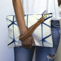 "I dream in indigo, my wanderlust starts at blue. The timeless appeal of blue and white is the inspiration behind the hand-dyed patterning on this organic cotton clutch.~ measures 9"" x 12.2..."