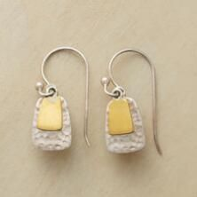 A pair of dangling brass tab earrings that mixes warm and cool elements to shining effect.