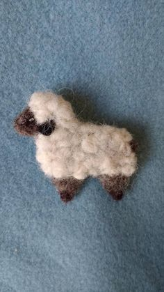 This is a listing for one sheep brooch.It was needle-felted with love from Merino wool in white and dark grey/black colour. Size: 6cm long x 5cm high approx It would make a beautiful handmade present for any occasion.