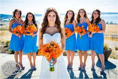 Portrait of bride and bridesmaids on the view patio at Chambers Bay Golf Course in University Place, by Tacoma wedding photographer Wallflower Photography