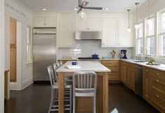 An easy way to update an oak kitchen...paint the overhead cabs. white. {Linden Hills Addition traditional kitchen}