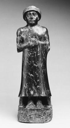 Statue of Ur-Ningirsu, son of Gudea  Period: Neo-Sumerian Date: ca. 2080 B.C. Geography: Mesopotamia, probably from Girsu (modern Tello) Culture: Neo-Sumerian Medium: Chlorite