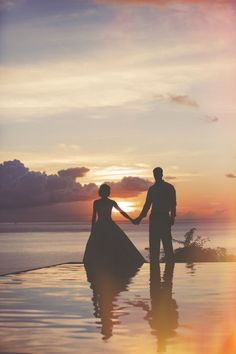 Pose for a photograph at sunset to capture the perfect wedding couple silhouette.