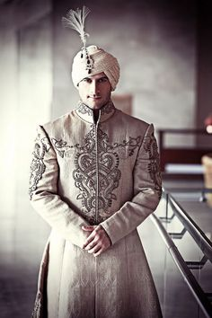Indian groom wearing sherwani and turban. Groom wear