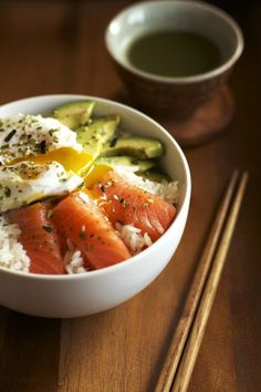 Salmon sashimi rice bowl with a poached egg and creamy avocado.