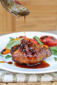 Balsamic Grilled Chicken with Spicy Honey Bacon Glaze from The Food Charlatan. This balsamic grilled chicken is SO full of flavor from the marinade. A quick stint on the grill and a 4-ingredient sauce top it off. Oh, did I mention the spicy honey and bacon? Yeah. #chicken #grilledchicken #grill #honey #bacon #marinade #balsamic #glaze #summer #healthy #recipe