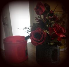 An empty Folgers plastic canister I painted with sandstone spray paint to make a flower arrangement.