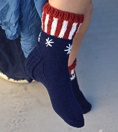These hand knit socks will warm your feet on a chilly day. We knit them in acrylic yarn and patriotic colors. They are great to wear around the