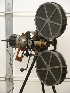 Panopiticon the first movie projector developed in the US was demonstrated today.note this is probably not that projector (picture) but it's interesting and I couldn't find the specific one. Antique Cameras, Old Cameras, Vintage Cameras, Photography Camera, Vintage Photography, Cinema Projector, Camera Obscura, Movie Camera, Silent Film