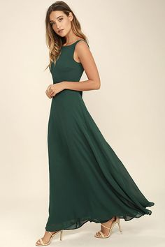 Special occasions call for That Special Something Forest Green Maxi Dress! Elegant chiffon fabric forms a sheer, sleeveless bodice with darting and a sultry, V-back. Satin sash ties at the waist above a cascading maxi skirt. Hidden back zipper/clasp.