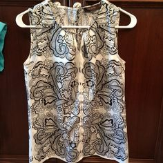Sleeveless Blouse Black and white sleeveless blouse, lightly worn. The Limited Tops Blouses
