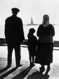 Italian immigrants look towards the Statue of Liberty as their ship approaches Ellis Island