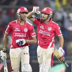 Kings XI Punjab's A Patel and R Dhawan celebrate after their win during the IPL 7 match against Delhi Daredevils in New Delhi, on May 19, 2014.