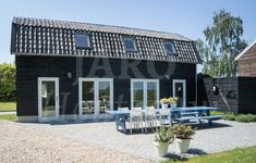Aanbouw van hout in Nieuwersluis, uitgevoerd met oud-Hollandse pannen