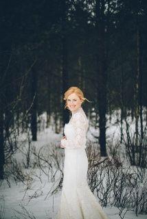 bride in long sleeve dress in snow