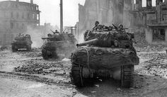 Battle of the Ruhr Pocket: Hunter tanks moving from the devastated streets of Muenchen-Gladbach, on March during Operation Grenade, the assault on the Roer River. Army Vehicles, Armored Vehicles, Granada, M10 Wolverine, M10 Tank Destroyer, Canadian Soldiers, Ww2 Photos, Ww2 Pictures, Sherman Tank
