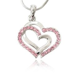 "Here is an adorable sparkling pink crystal double heart charm pendant necklace. Pendant measures approximately 3/4"" in length. It comes on a beautiful silvertone 16"" snake chain. This classy piece is perfect for gift giving or for yourself. Your necklace will come to you in a foil gift box. Box may be a different color than the one shown."