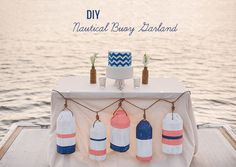 Genius!  DIY buoy garland, made out of cardboard + canvas drop cloth + paint!