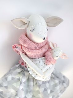 Deer Girl with baby.  Great for children and adults.  Deer is wearing a skirt, blouse, scarf and she has little baby :-) Clothing is removable. He is 45 cm long from head to legs. The face is hand embroidered.  Doll was handmade with love and care.  100 % cotton body. Toy are for decoration or play :)